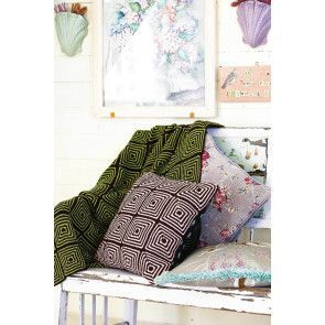 Knitted geometric cushion and matching throw