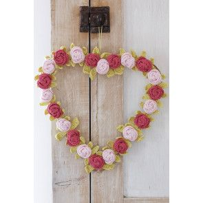 Crocheted heart shaped wreath with flowers and leaves