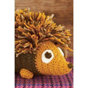 Crocheted hedgehog with tasselled back and cute face