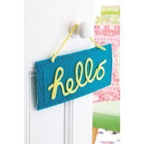 Knitted hello sign to hang in the home