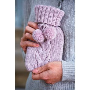 Tiny knitted hot water bottle cover with cable, pom-poms and deep cuff