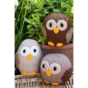 Three different knitted owls with yellow beaks and feet