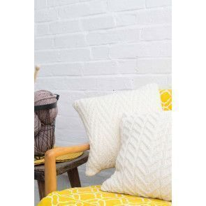 Cream knitted cushions with stylish textured designs