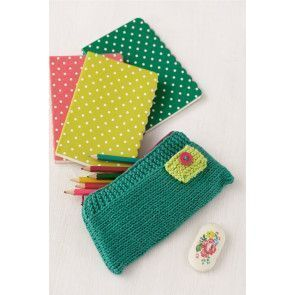 Small knitted childrens pencil holder with button
