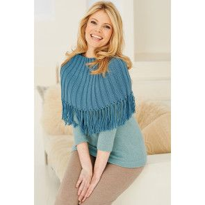 Knitted fringed cape for a woman with long tassels along border