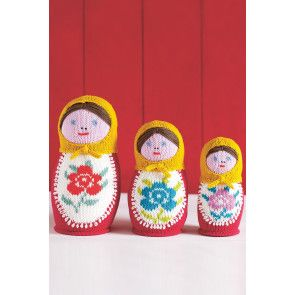 Three knitted Russian dolls with headscarves and floral motifs on bodies