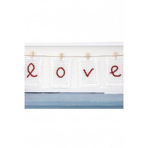 Crocheted love decoration with square mesh embroidery