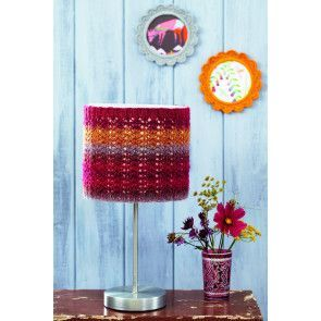 Knitted lampshade with red, orange and purple stripes