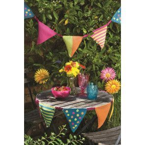 Colourful knitted bunting with spots, stripes and plain triangles