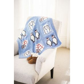 blue knitted baby blanket with intarsia penguins and igloos