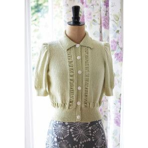 Vintage knit cardigan with ruffled details and short puff sleeves