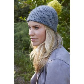 ladies pom pom hat knitted in chunky yarn