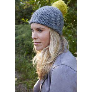 ladies pom pom hat knitted in chunky yarn