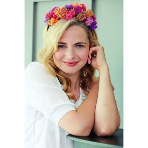 Brightly coloured knitted floral hair accessory for ladies