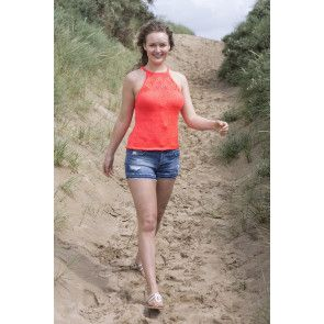 Lady wearing a bright summer top with halterneck