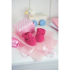 Tiny crocheted shoes for a newborn baby in fuchsia pink