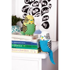 Colourful knitted budgie toys with stripes