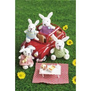 Knitted family of rabbits with different outfits