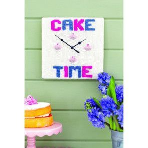 Knitted clock face with cake motif